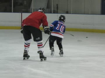 father and son ice hockey